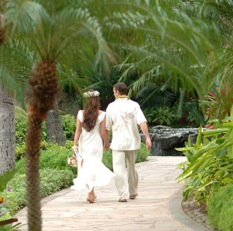 Just married couple walking through the resort